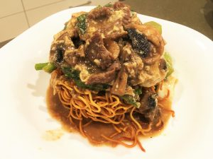 Ee-mein with beef and mushroom sauce